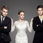 Two handsome men and beautiful woman. Studio, trendy, strict look